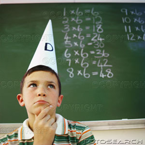 Kid in dunce cap